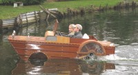 DUCKW wooden amphibeous car exiting water